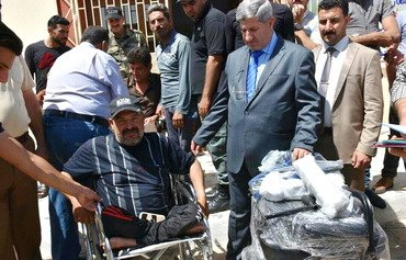 Anbar residents disabled by ISIS receive help