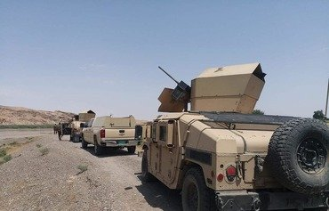 Iraqi forces search mountains in southern al-Sharqat