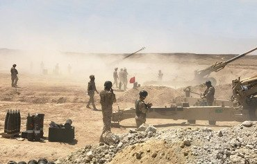 Iraqi, coalition artillery pound ISIS sites in Syria