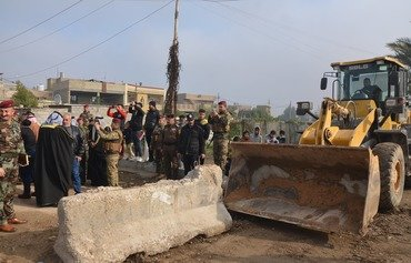 Baghdad removes concrete barriers, checkpoints from streets