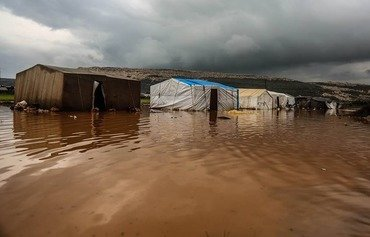 Heavy rains flood tents of displaced in Syria's north