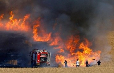 Fires consume large swathes of Iraqi farmland