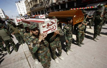 Iran-aligned militias store weapons in populated Iraqi cities