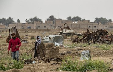 Al-Baghouz residents clean detritus of war one year after ISIS