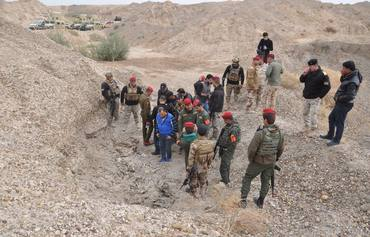Iraqi forces uncover ISIS mass grave in Heet