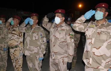 Moment of solidarity in Iraq with coronavirus victims, first responders