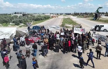 Syrian activists protest on M4 highway in Idlib