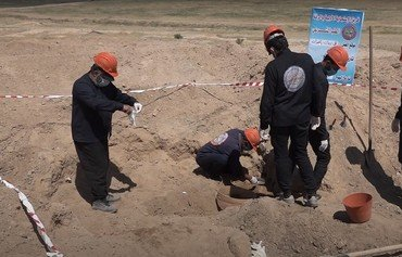 Exhumation under way at al-Raqa mass grave