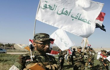 Iraqis call on militias to leave liberated areas