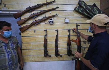 Militias sell illegally seized arms in Baghdad, southern Iraq
